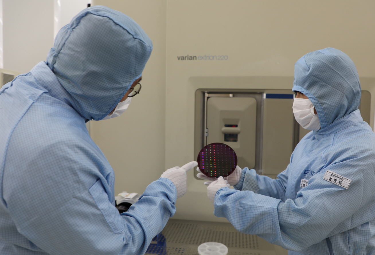 Researchers working on CMOS wafers